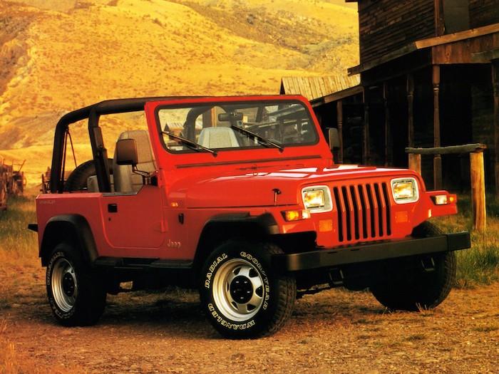 Jeep Wrangler rouge de 3/4 face